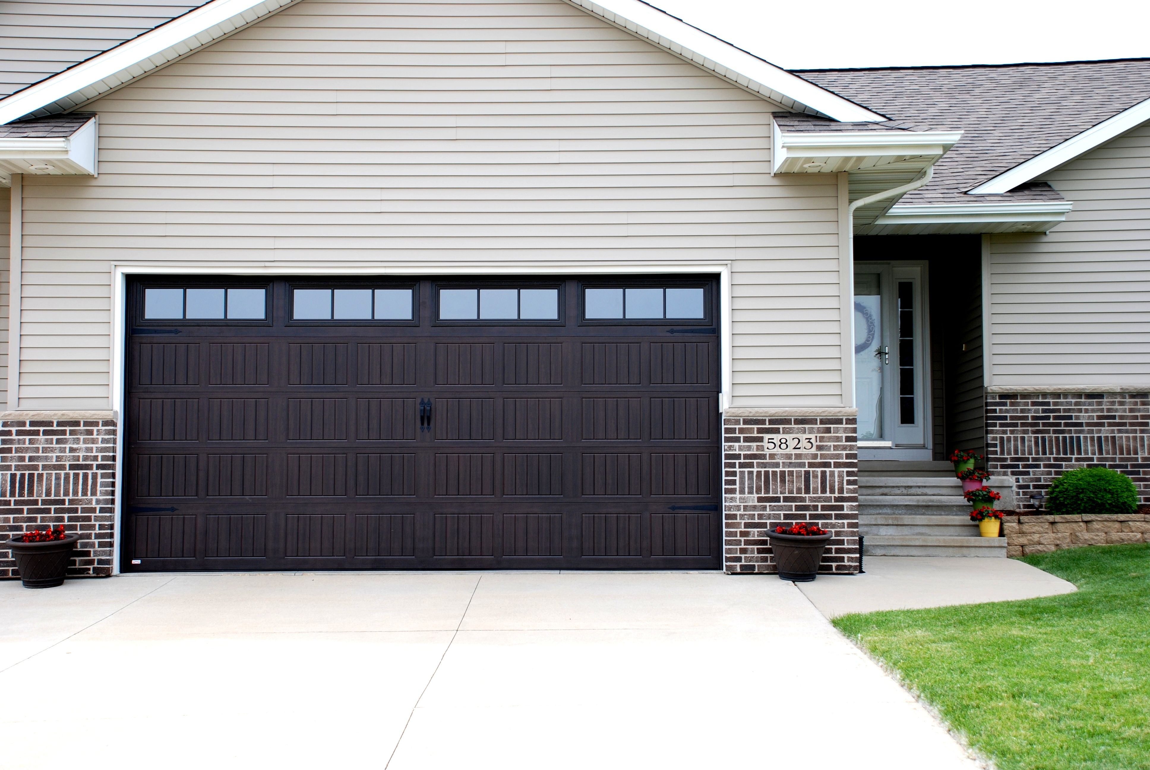 Thermacore Model 199 Walnut Stain Stockbridge Windows Garage Door Accessories Metal Door Garage Doors