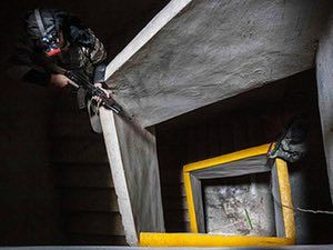 20 Photos: Free Syrian Army fighters aiming their weapons inside an abandoned building