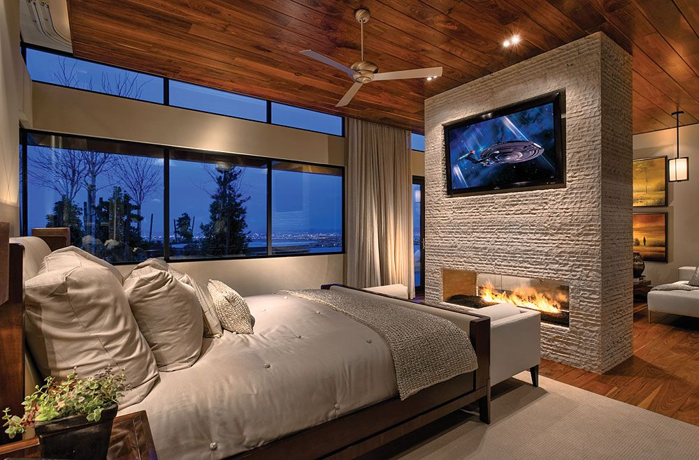This bedroom is my perfect dream master bedroom!! Fireplace and stone love<3