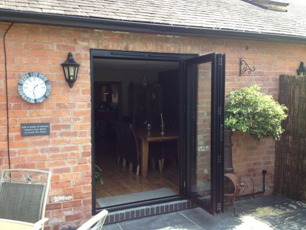 a small set of bi-folding doors opened and stacked to allow access ...