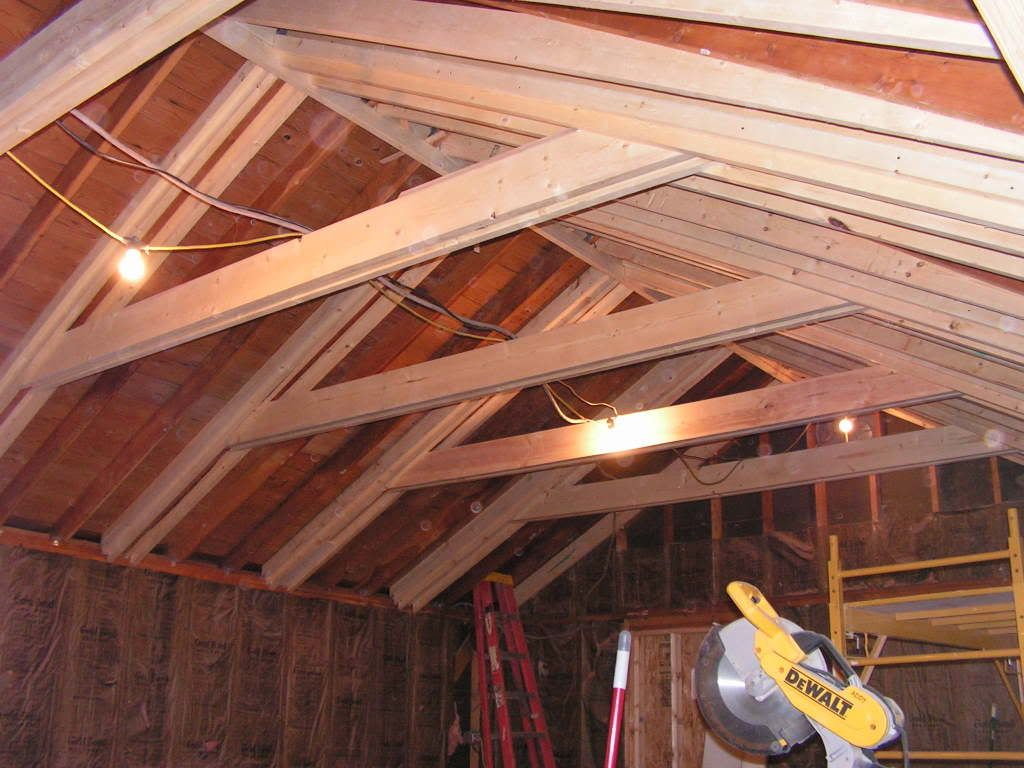 Opening up the attic to increase ceiling height and sense for Raise garage door height