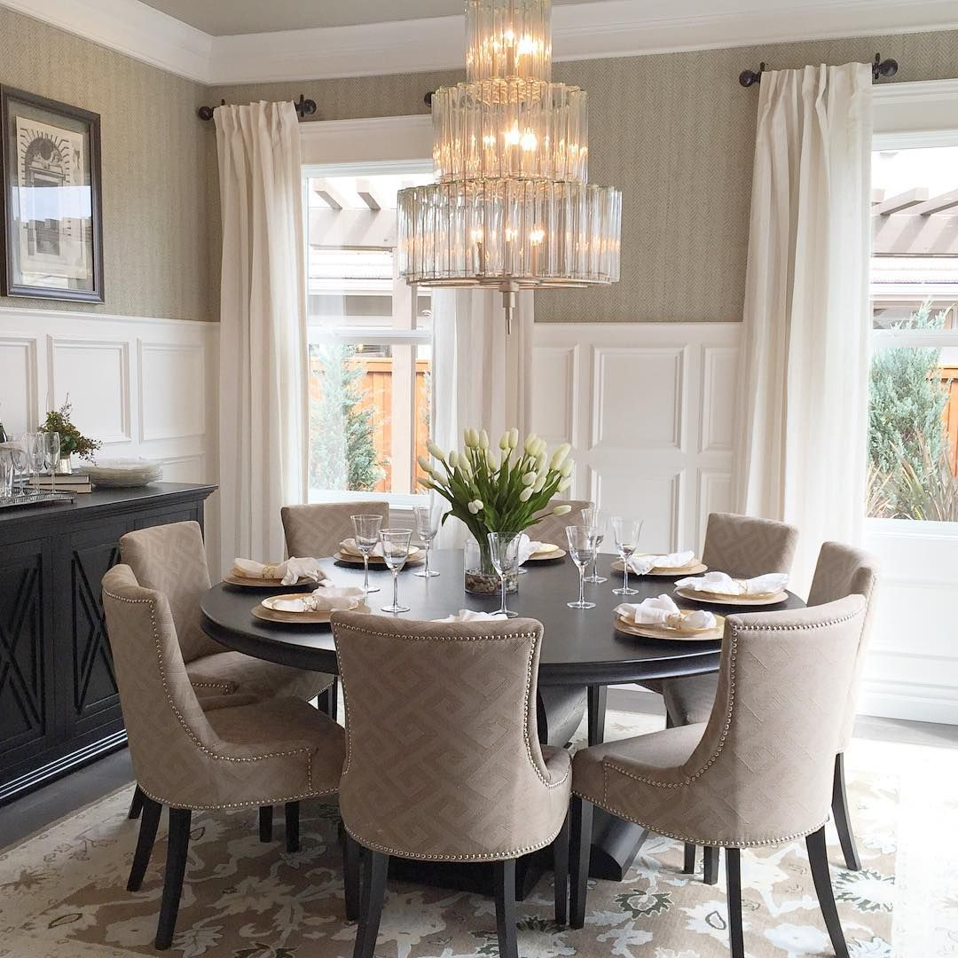 Elegant Dining Room With Round Table And 8 Upholstered Chairs