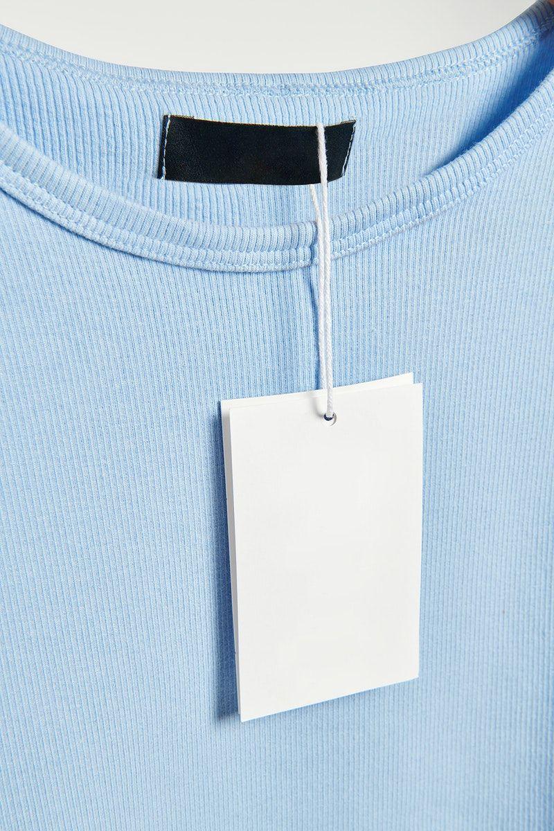 Download Download Premium Psd Of Blue T Shirt With A Tag Mockup 2646793 Clothing Mockup Mockup Blue Tshirt