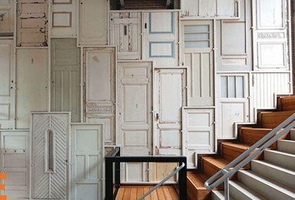 multiple door wall.  kinda love it.  kinda think itd make me feel insane.  via design is mine : isnt it lovely?