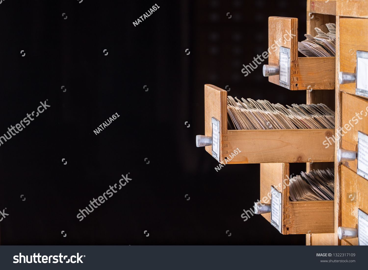Library or archive reference card catalog Database knowledge base concept Old library or archive reference catalogue with opened card drawer