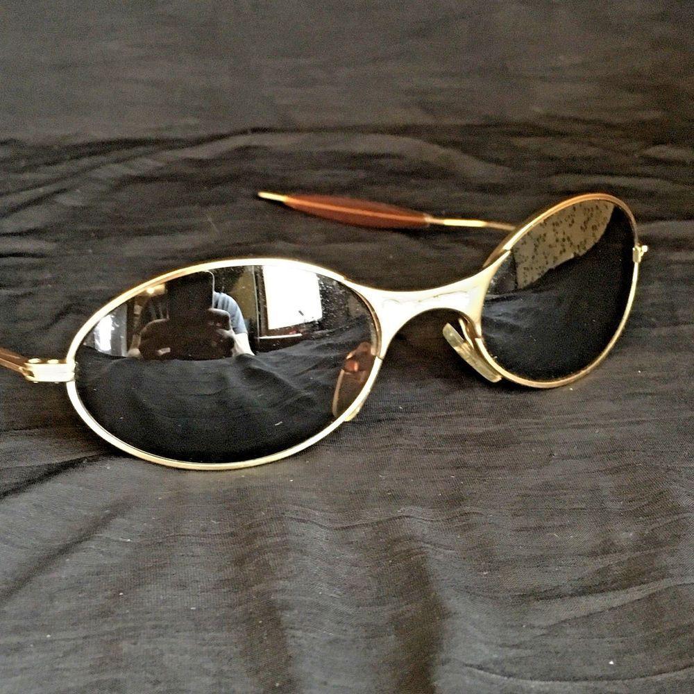 7e813384d7 Vintage OAKLEY Sunglasses Metal Frame Gold Tone Oval Lenses Unisex  Oakley   Oval