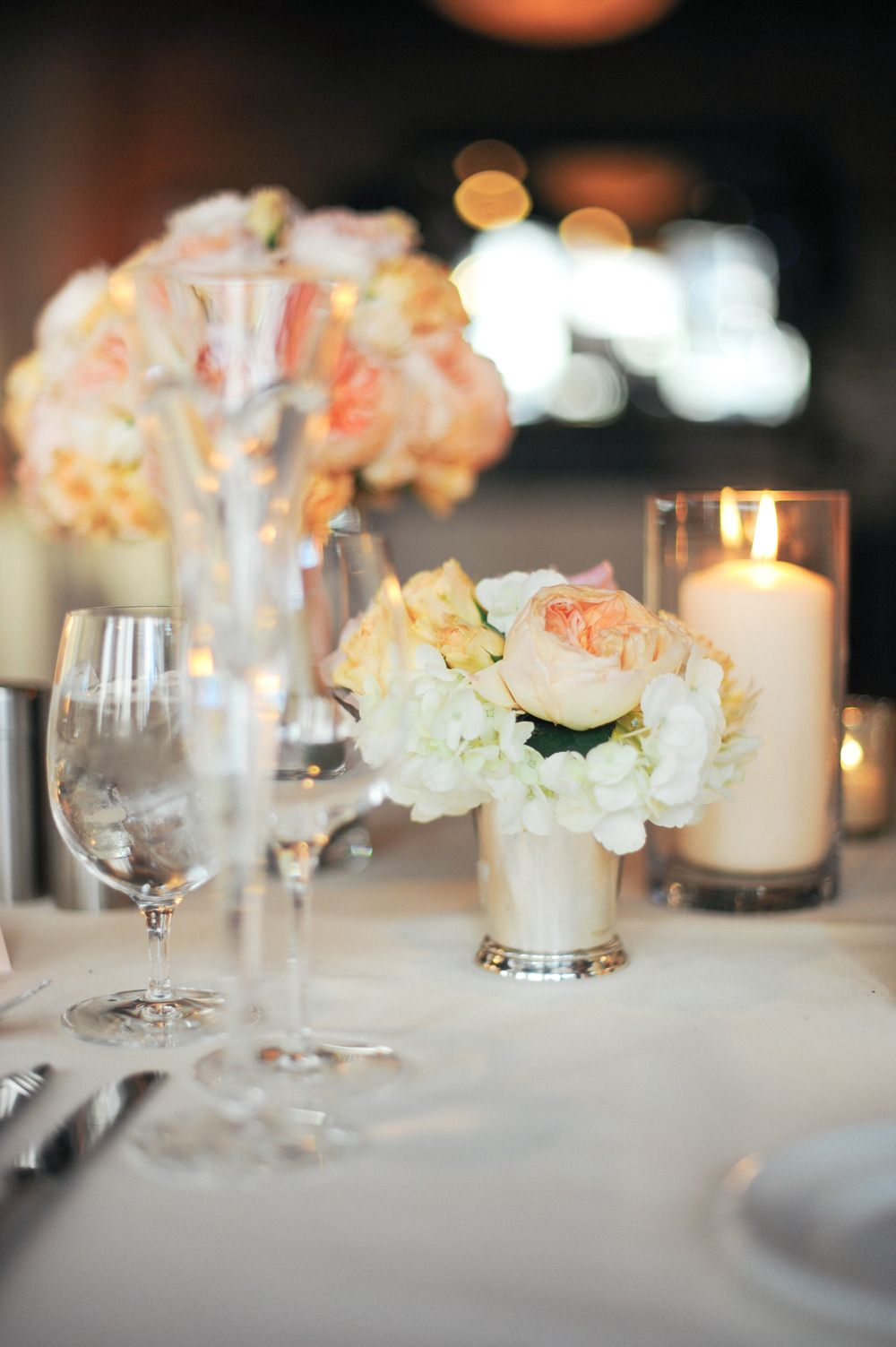 Tuck these little posies between candles and it's pure romance! See the wedding: http://www.stylemepretty.com/illinois-weddings/2013/11/11/modern-chicago-wedding-from-erica-rose-photography | Photography: Erica Rose Photography