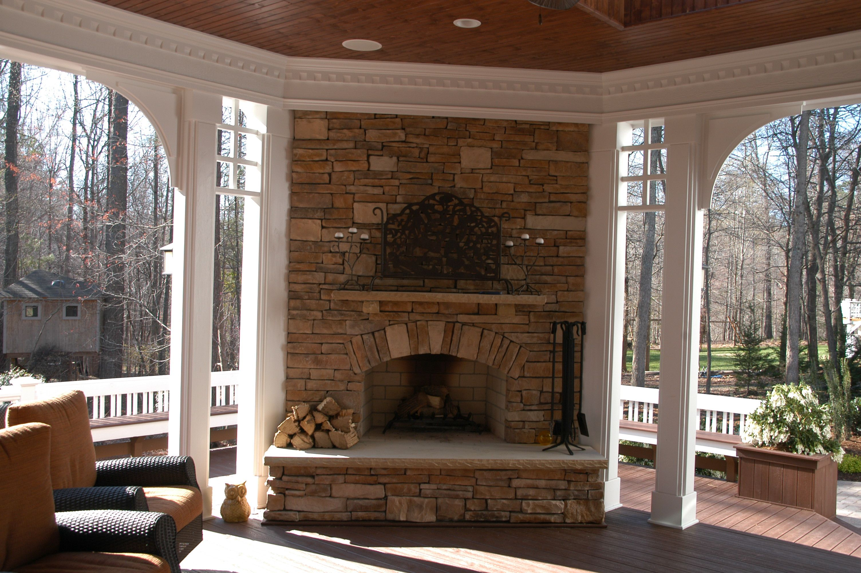 Covered Deck and Fireplace by Paradise Decking