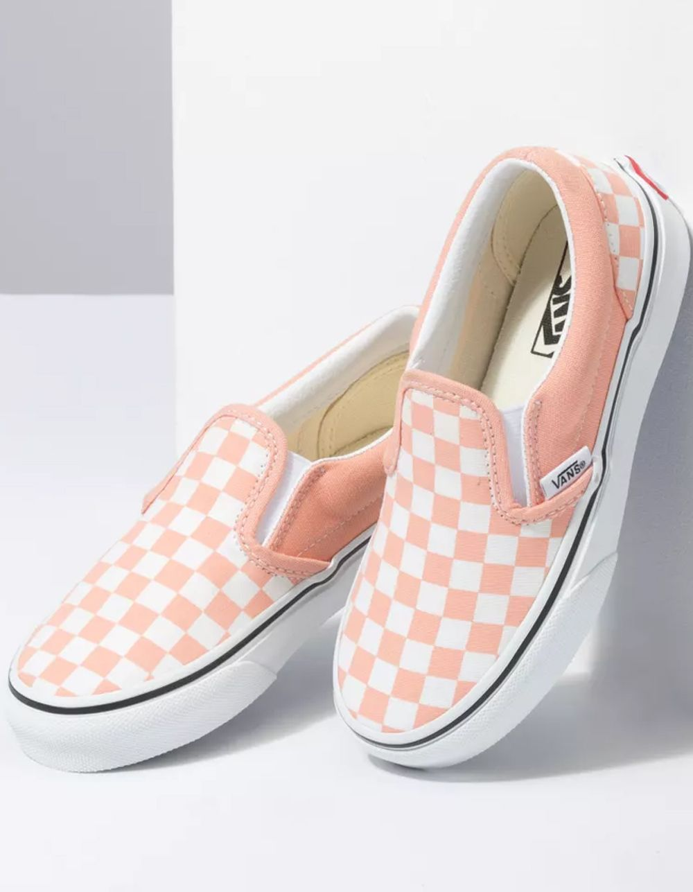 Vans Checkerboard Classic Slip-On Shoes. The Checkerboard Kids Classic Slip-On features sturdy low profile slip-on canvas uppers with the iconic Vans checkerboard print, padded collars, elastic side accents, and signature rubber waffle outsoles. Imported.