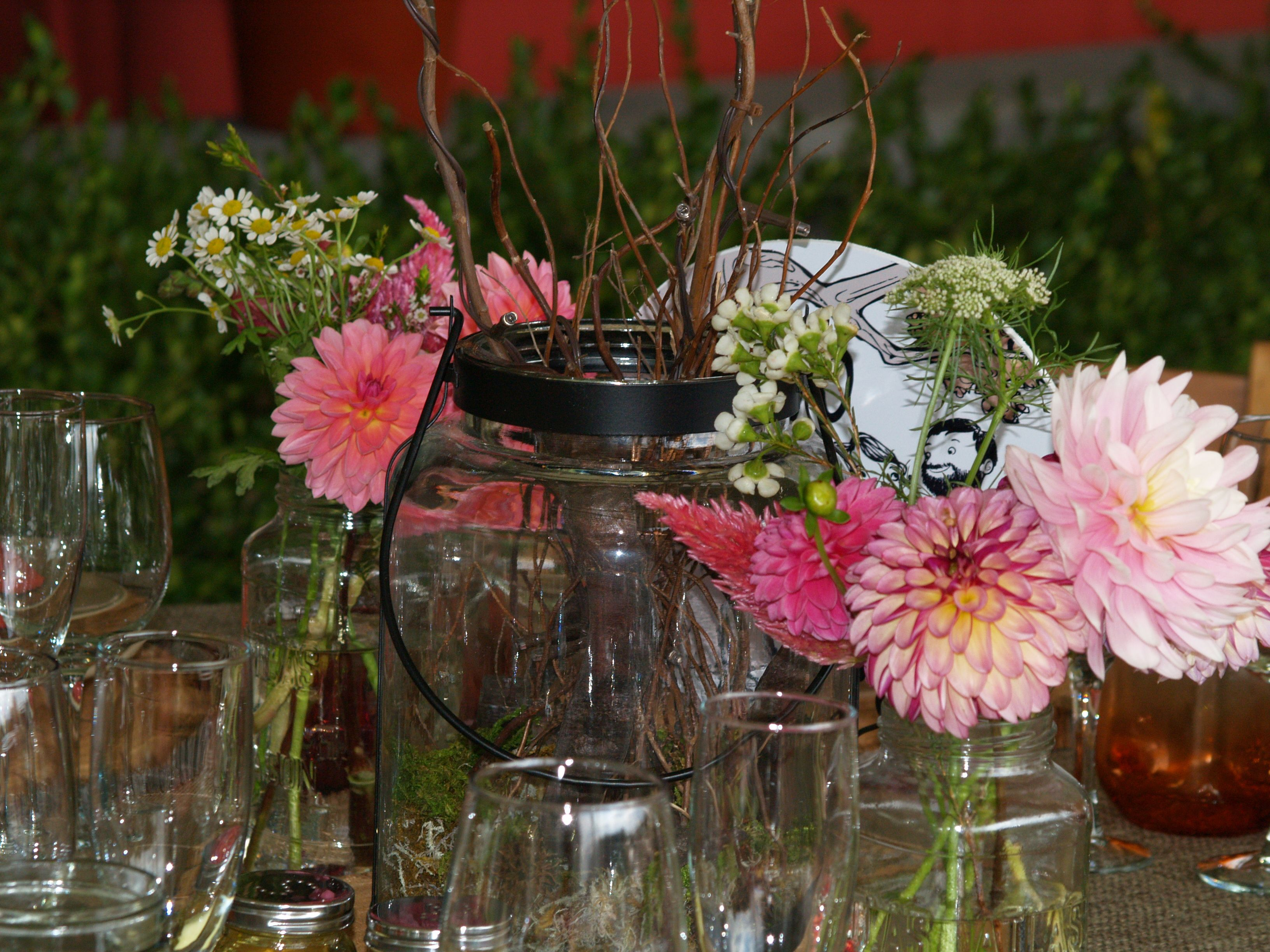 Mason jar centerpieces with dahlias and field grown flowers