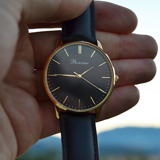 Classic Black with 40 mm polished gold case, brushed black dial and black leather strap. Free shipping worldwide - www.bonvier.com #bonvier #watches #orologi