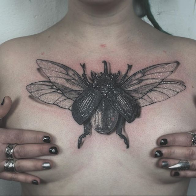 Front view of yesterterday's final touches on Emma's chest bug!  thank you for the giggles lady! ❤️ (fresh ouline, white and drop shadows, dotwork healed)   #dotrealism #dotwork #dotworkers #dotworktattoo #delphinenoiztoy #thelacemakerssweatshop #blackwork #blackworkers #chestpiece #tattoo #uktta #tttism