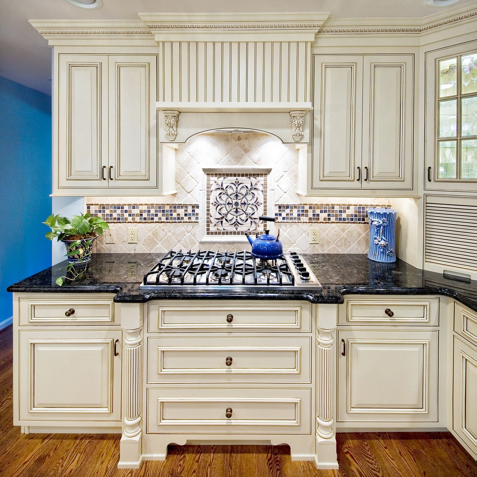 Kitchen Backsplash Blue mexican tile with granite | white kitchen cabinets with black