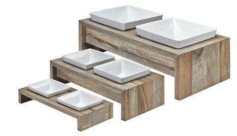 Fossil Gray Elevated Dog Feeder Gray finished Rubberwood elevated diners let your pet dine in luxury Includes white, lead-free and dishwasher safe, ceramic bowls in 3 sizes. Wood finish is water repellent and easily wipes clean. All stands have anti-slip cushioned feet.