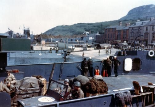 Loading vehicles and equipment on LCT Channel Fever prior to Operation Overlord, the D-Day invasion of Normandy, France, 6 June 1944. The yellow paint indicates Vesicant Detector M5 that changes color in contact with chemical warfare agents