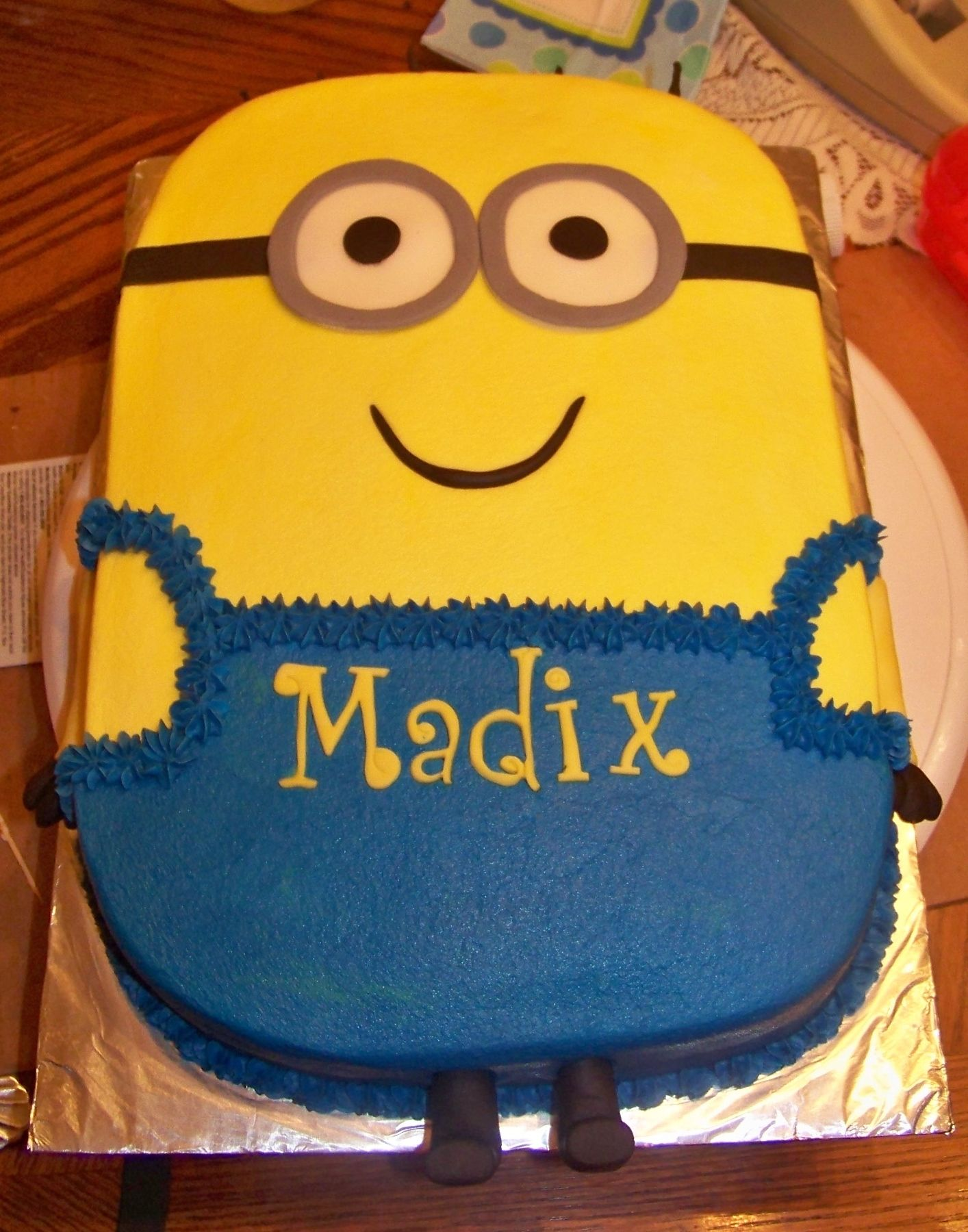 Minion This is a minion cake iced in bc with fondant accents