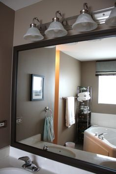 Framing a Mirror - I can do this in my bathroom so I don't have to buy a brand new mirror and can cover up the bad spots on the edges!