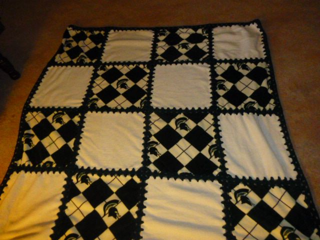 """New handmade crocheted Fleece Blanket w/ MIchigan State with off white solid squares, It is approx 58""""x58"""". It is on sale for 25.00 plus S&H Millington M"""