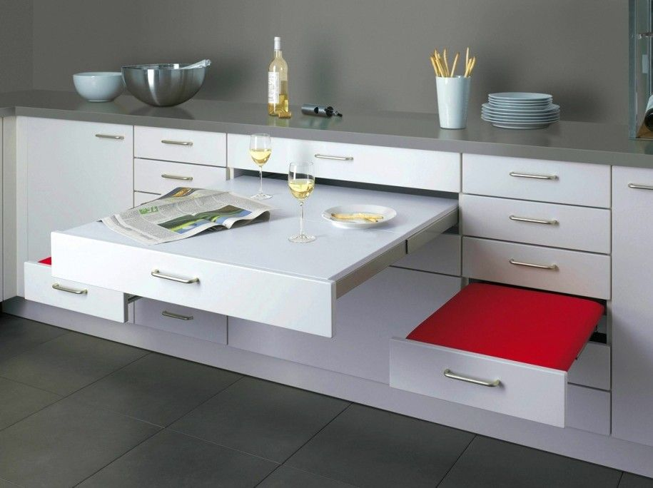 Compact Grey Kitchen With Space Saving Red White Pull Out Dining Table Magnificent And Multifunctional Compact Kitchen Design For Efficient Kitchen Cabinet Design