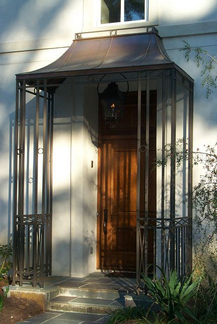 Custom Copper Awning With Wrought Iron Decorative Supports