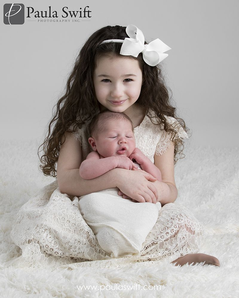 Boston newborn photographer 5 year old with her 2 week old baby brother by paula swift photography in sudbury ma newbornphotography