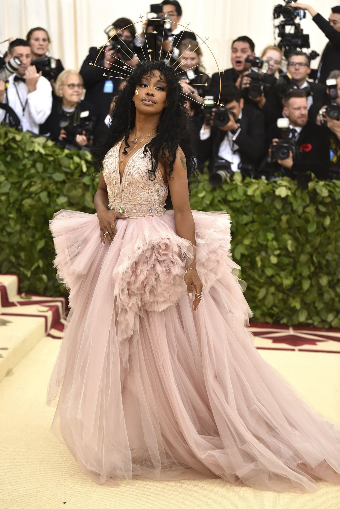 At the met gala stars show off their saintly side with classic
