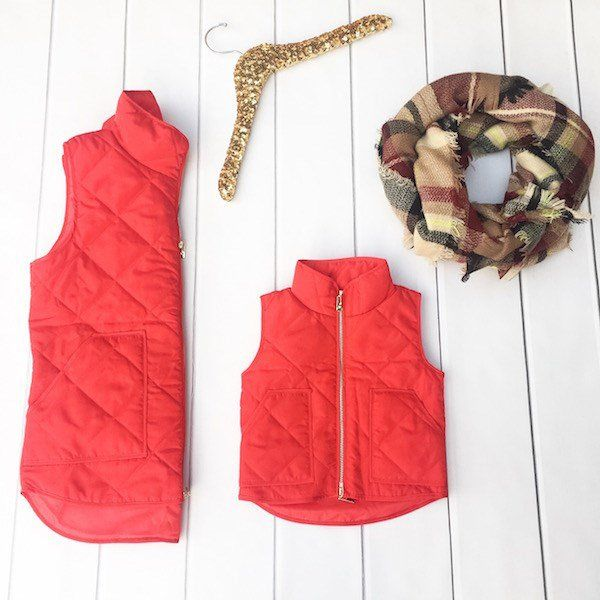 """Because every gal needs the PERFECT, High Quality Puffer Vest, we have designed 2 AMAZING colors just for you. Our New Buffalo Plaid (Navy & White) Vest, and our Red Vest are the perfect vest for this season and the fit on these is amazing! These gorgeous vests can be styled with so many outfits, we don't even know where to begin. Let's face it, Puffer Vests are here to stay. The BEST part is that these come in real women's sizes and we've made the same exact ones for your """"Mini""""..."""