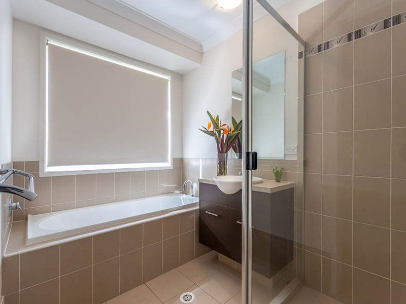 bathroom in gatton queensland lovely coffee colour tiles with white bath and timber vanity - Bathroom Tile Ideas Colour