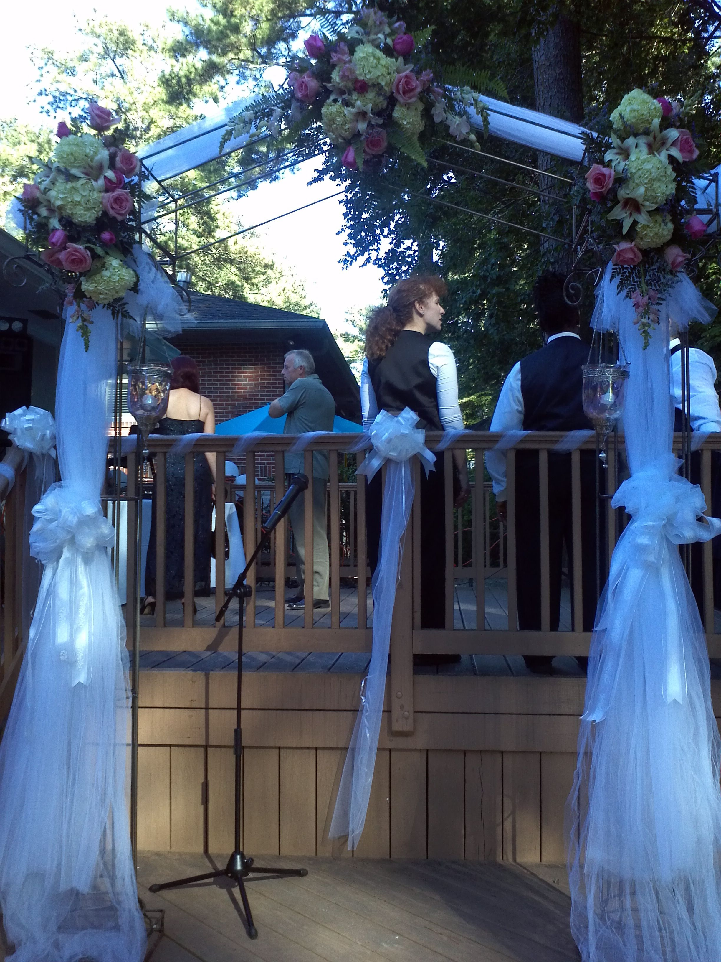 Traditional wedding decor blue and white  Arch Decor with white hydrangea u pink roses  Wedding Flowers