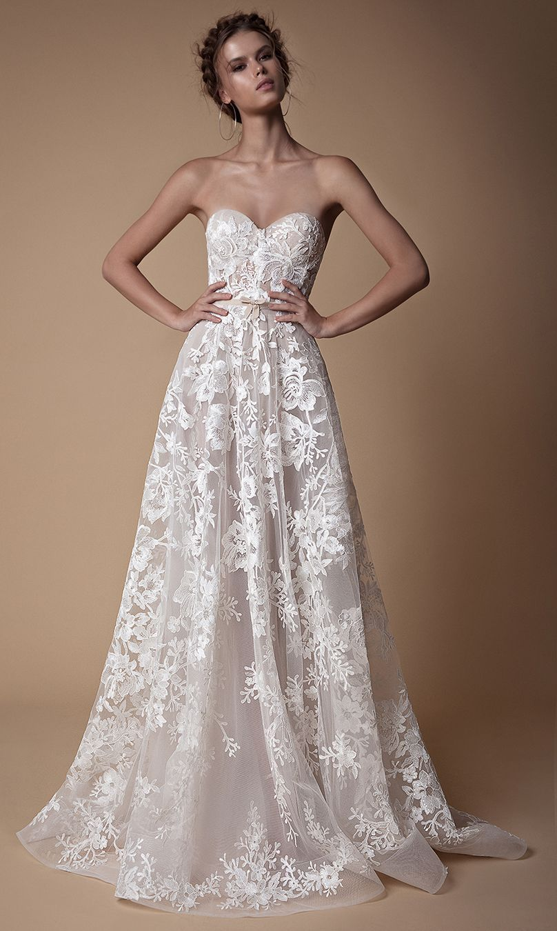 Beautiful strapless wedding gown with fine embroidered details and a