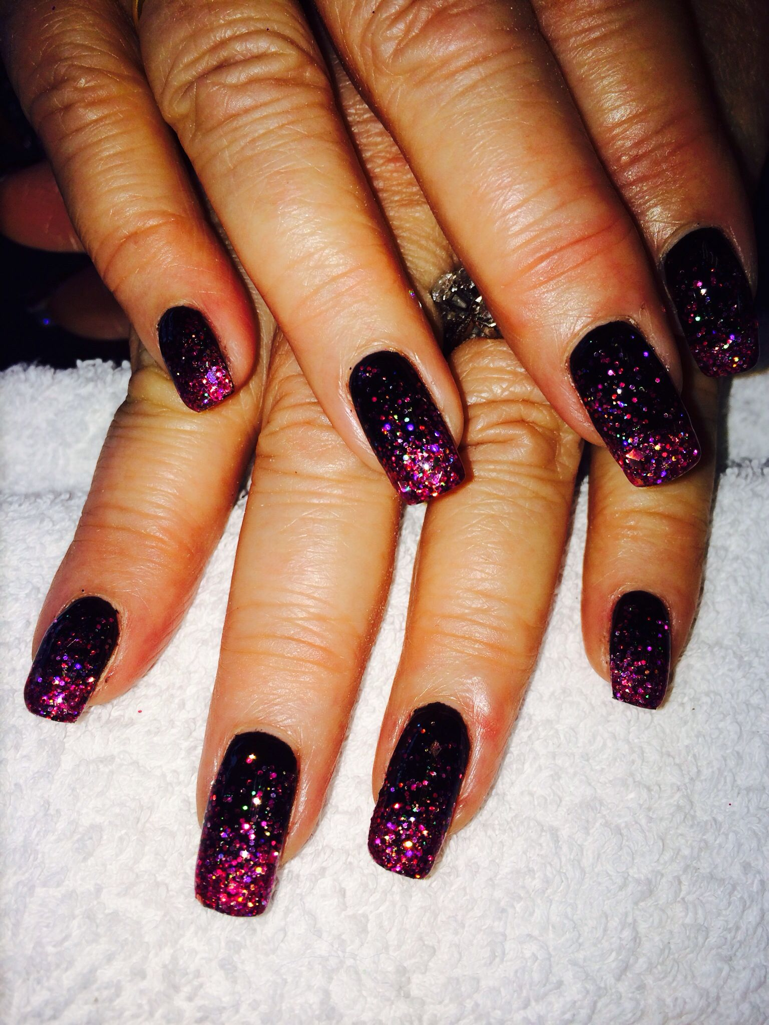 fabulous black bio sculpture gel nails with pink faded glitter