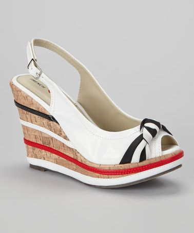 sale retailer ea4f8 2f2ea Take a look at this White Gilda Slingback Wedge by MARIO ...