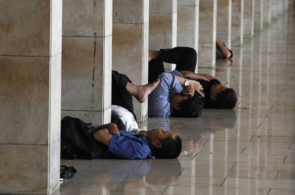 Observing Ramadan | People nap while waiting to break their fast in Istiqlal mosque during the first day of the holy fasting month of Ramadan in Jakarta, on July 10, 2013. | The Atlantic/Reuters/Enny Nuraheni