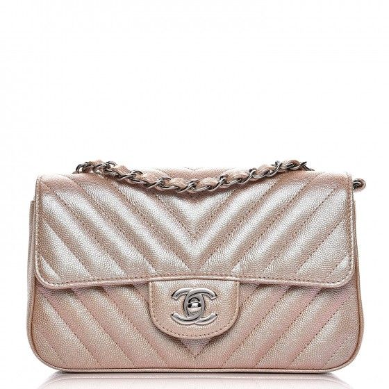 8b57ef313d24 This is an authentic CHANEL Iridescent Caviar Chevron Quilted Mini  Rectangular Flap in Light Gold. This classic flap bag is crafted of chevron  quilted ...