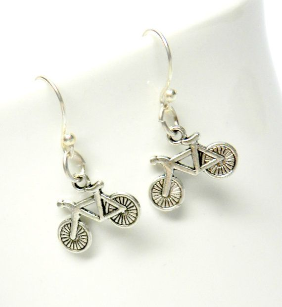 These little handcrafted silver toned bicycle drop earrings are such fun. And what a great gift for the bicycle enthusiast! And a terrific