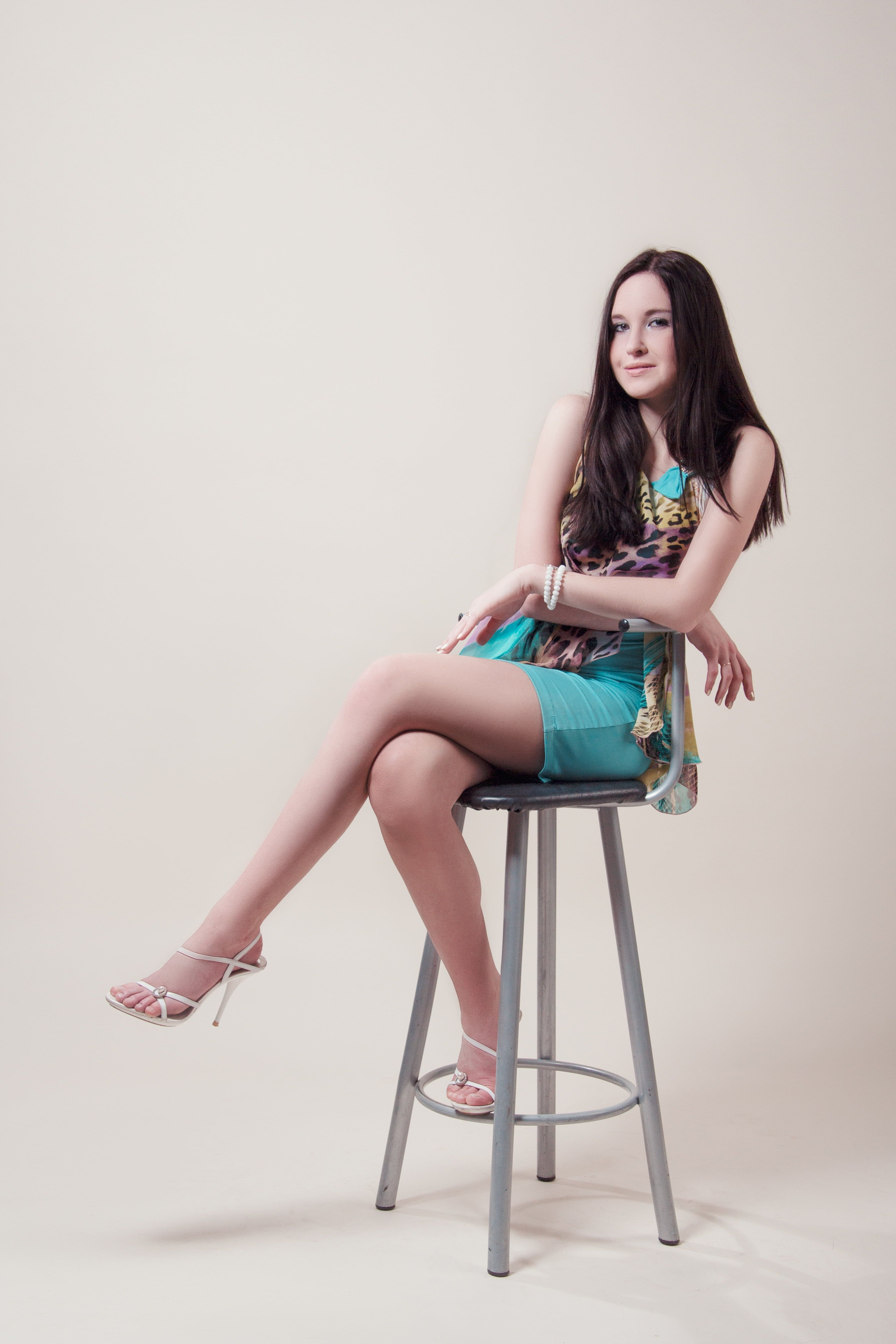 Woman Sitting In Chair In Dress