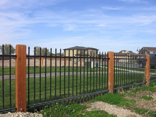 Cedar And Wrought Iron Fencing With Images Rod Iron Fences
