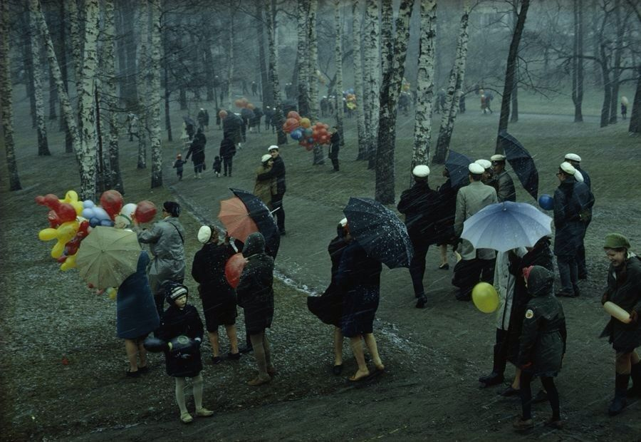 People strolling through a park in Finland during a wet May snowstorm in 1968 by George F. Mobley for NGC