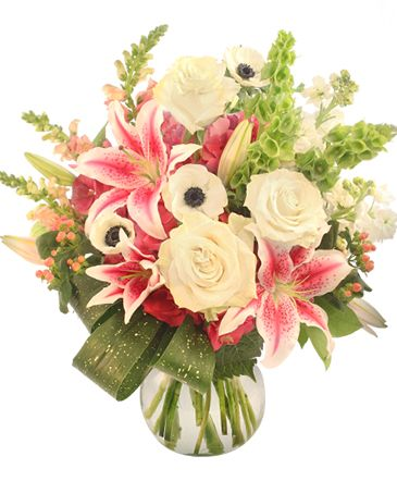 Step up your romance game this year and show your forever love with our Love is Eternal Arrangement. This fresh pink, white and green bouquet features the timeless beauty of pink lilies and snapdragons, white anemone, roses and stock, and exotic green bells of Ireland.