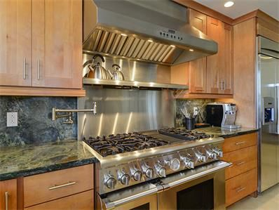 Gourmet kitchen with Thermador appliances, including a 6-burner ...