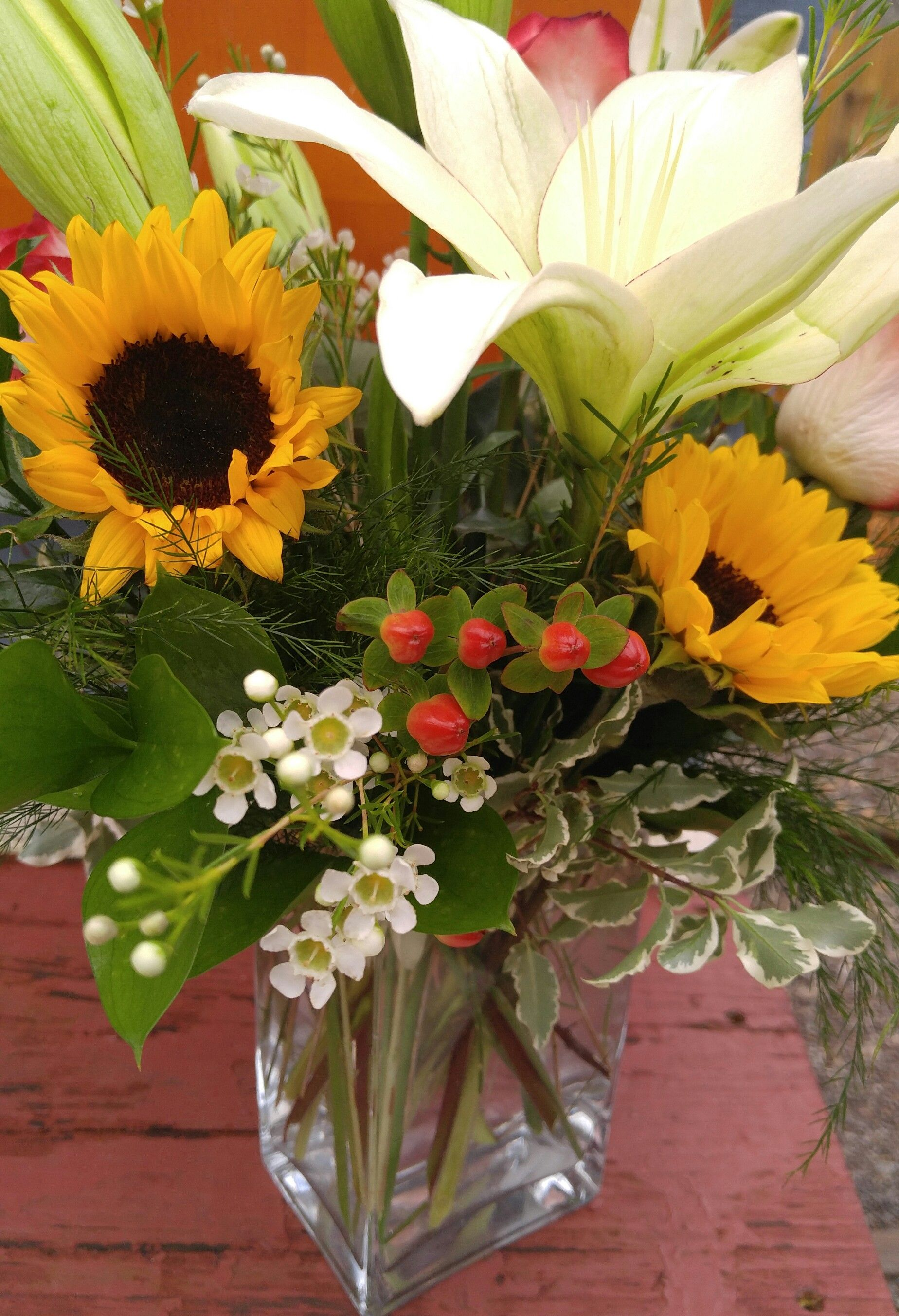 McKenzie Botanicals Mix of Hybrid lilies, wax flowers