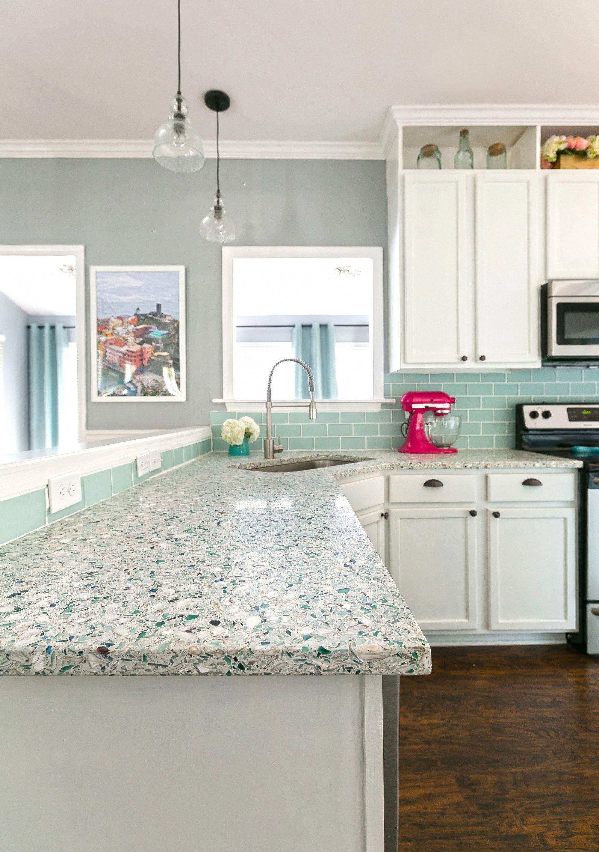 Diy Renovated Coastal Kitchen With Light And Bright Shades Of Blue And White Recycled Glass And Oys Coastal Kitchen Design Coastal Kitchen Mint Green Kitchen