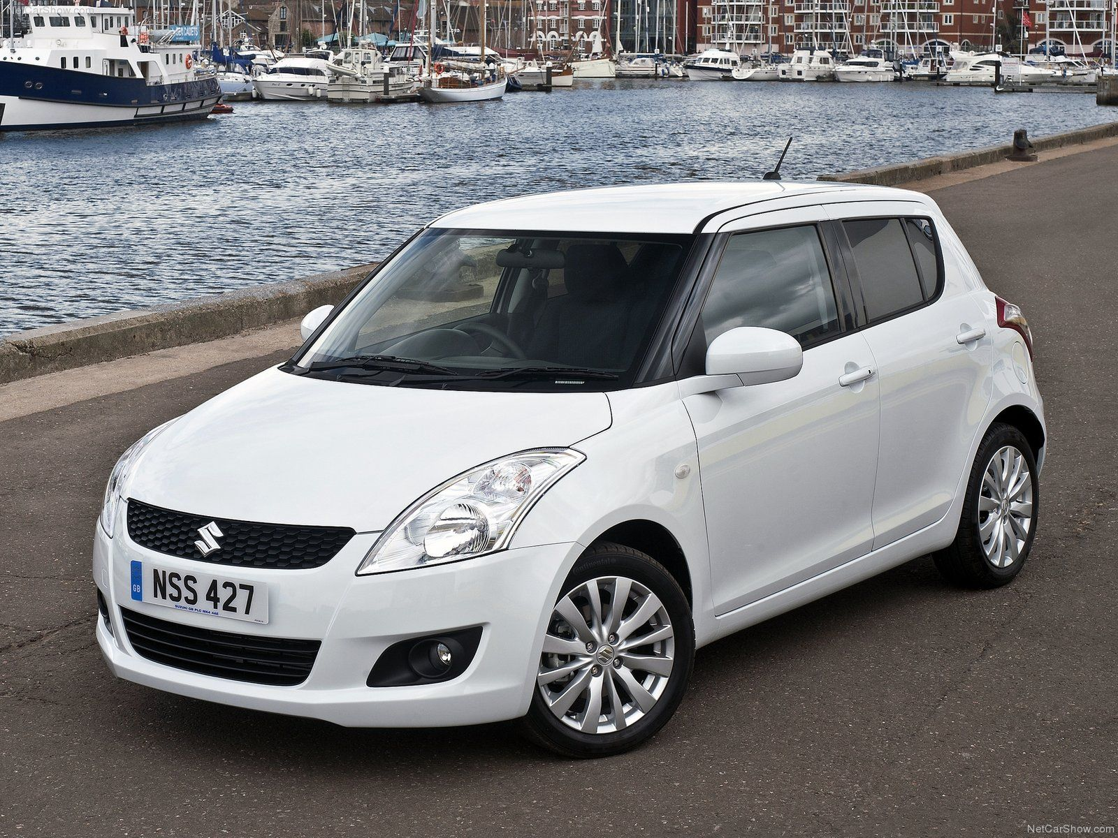 Suzuki swift automobile that is perfect for city driving with a length of 3850
