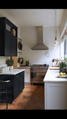 black and white in a small kitchen, love the herringbone floor