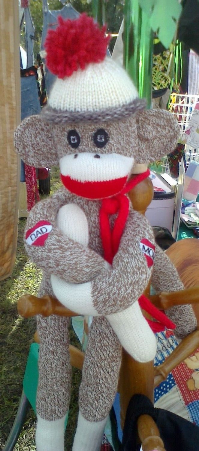 Traditional sock monkey with Mom and Dad tattoo by