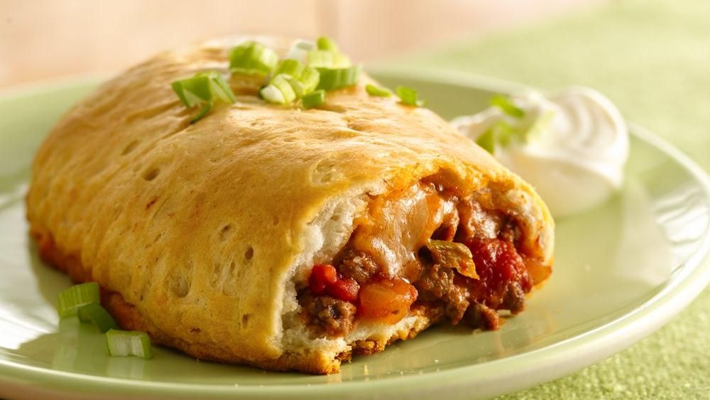 Taco flavor wrapped in an empanada, and it's ready to eat in 30 minutes! Try ground turkey,  spaghetti sauce (or sloppy joes) and mozzarella.