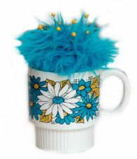 Funky Pincushion - I'm pretty sure I picked one of these up at a thrift store but in yellow and oranges.  hehe