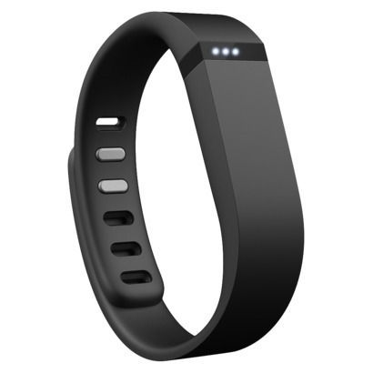 A #Fitbit flex to count her steps and keep her accountable. It's simple chic design doesn't interfere with her other jewelry.