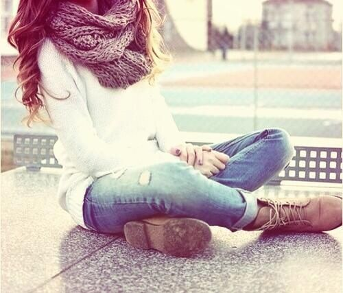 Sweater, slightly ripped jeans, brown combat boots, and a scarf
