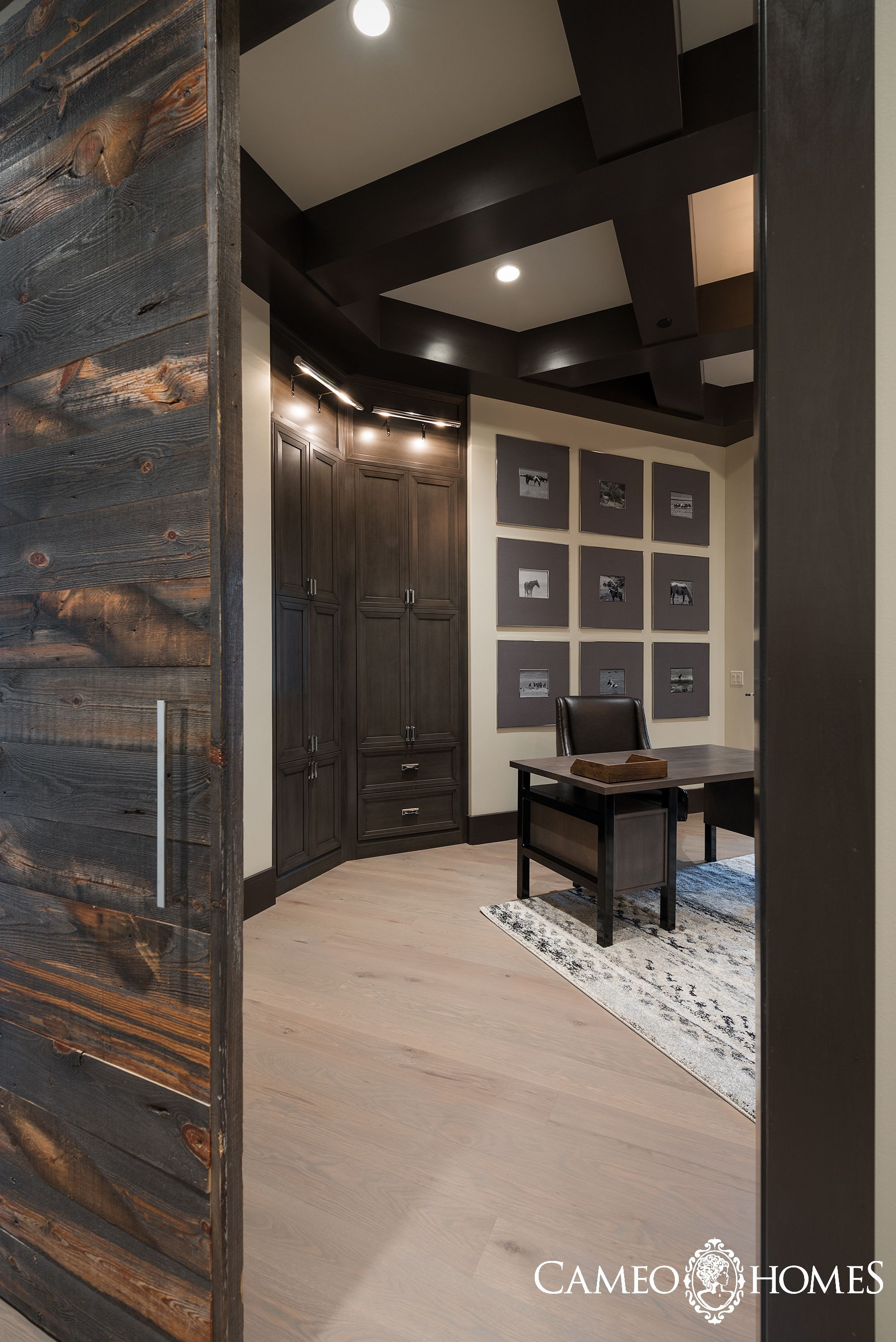 Home Office with a sliding wood door using reclaimed wood. Utah ...